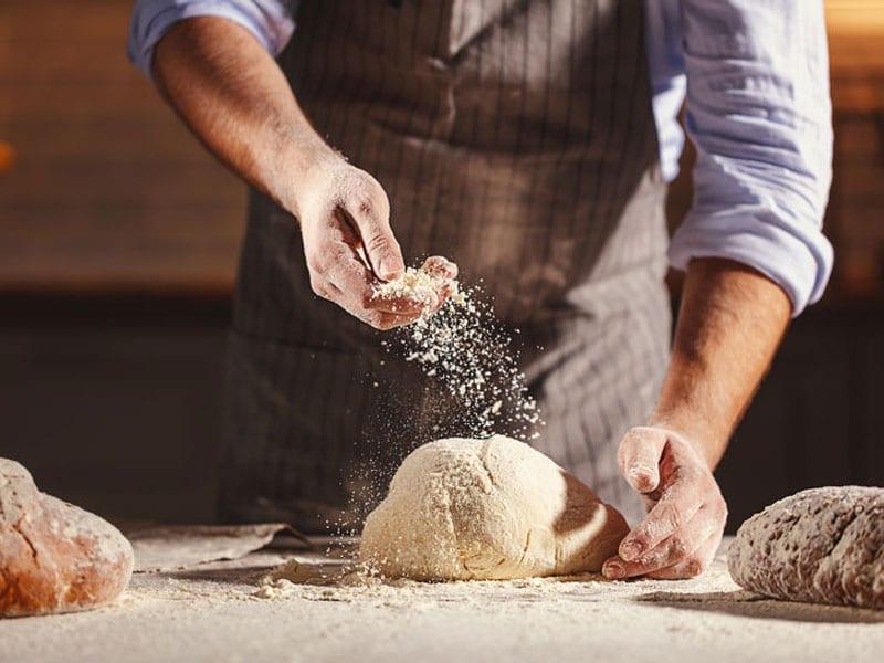 Brot Backen, Teig und Mehl. Hands of the baker's male knead dough, © Evgeny Atamanenko, # 101297262 123rf.com.